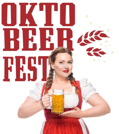 """attractive waitress in traditional bavarian dress holding mug of light beer isolated on white background with """"oktoberfest"""" lettering"""