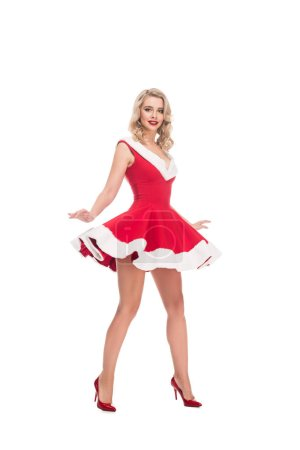 young seductive woman raising up christmas dress isolated on white