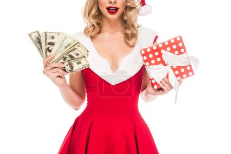 partial view of santa girl in christmas hat holding cash money and gift box isolated on white