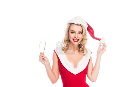 smiling young woman in christmas dress holding champagne glass isolated on white