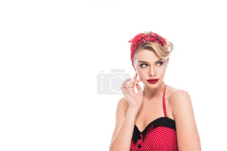 portrait of pensive pin up woman looking away isolated on white