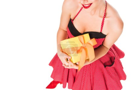 Photo for Cropped shot of smiling woman in pin up clothing holding gift isolated on white - Royalty Free Image