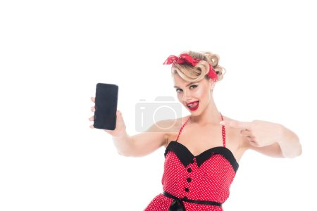 Photo for Portrait of beautiful pin up woman showing smartphone with blank screen isolated on white - Royalty Free Image