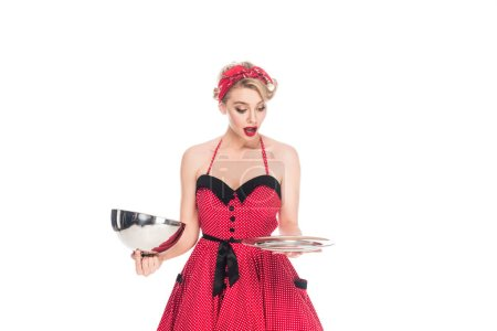 Photo for Portrait of shocked pin up woman looking at empty serving tray in hands isolated on white - Royalty Free Image