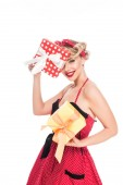 portrait of beautiful pin up woman with wrapped presents isolated on white