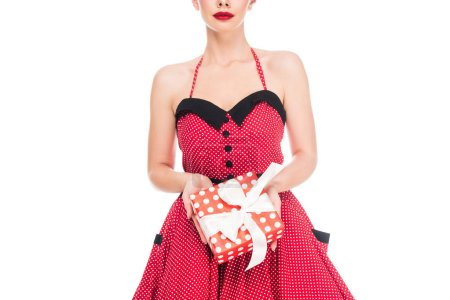 Photo for Cropped shot of pin up lady holding wrapped gift isolated on white - Royalty Free Image