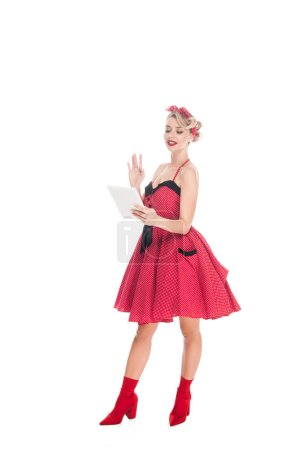 stylish woman in pin up clothing with digital tablet isolated on white