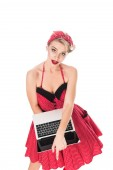 high angle view of attractive woman in pin up style clothing with laptop isolated on white