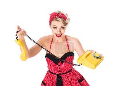 high angle view of excited woman in pin up dress with retro telephone isolated on white
