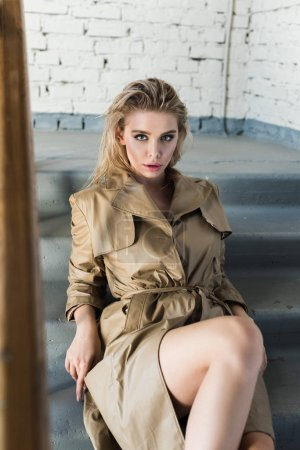 Photo for Portrait of beautiful blond model sitting on stairs - Royalty Free Image