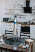 rocket model and tools for designing on table in kitchen