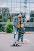 happy father and little son launching model rocket outdoor