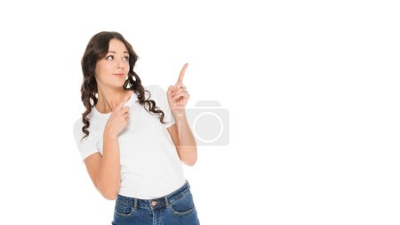attractive girl pointing at something isolated on white