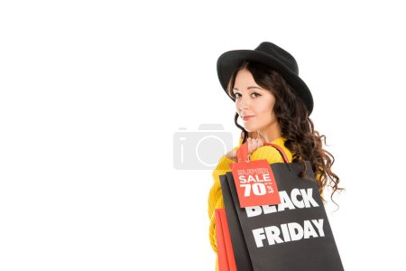 attractive fashionable shopaholic holding shopping bags on black friday sale, isolated on white