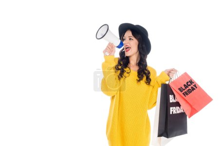 emotional customer with shopping bags yelling into megaphone for promotion of black friday isolated on white