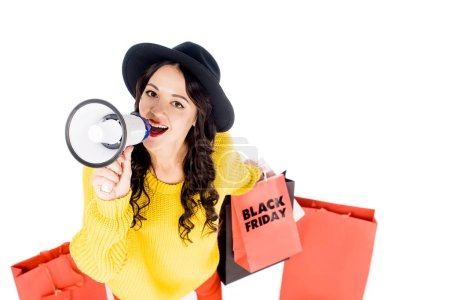 emotional girl with shopping bags yelling into megaphone for promotion of black friday isolated on white
