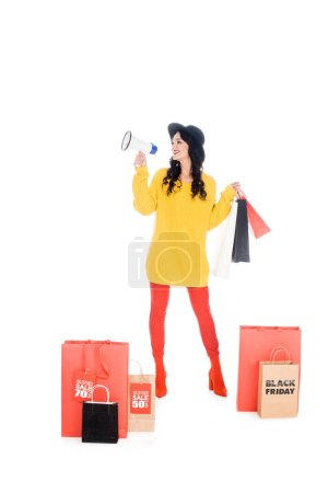 fashionable shopaholic with shopping bags screaming into megaphone for promotion of black friday isolated on white