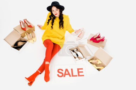 beautiful stylish girl with sale symbol isolated on white with footwear