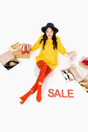 attractive stylish girl with sale symbol isolated on white with shoes