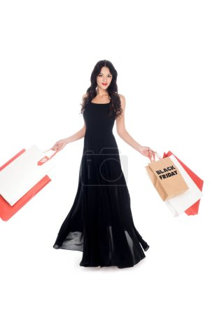 elegant beautiful woman in black dress with shopping bags isolated on white