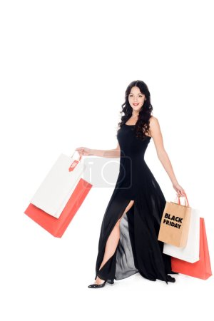beautiful elegant woman in black dress with shopping bags isolated on white