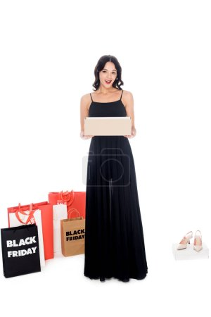 attractive woman holding footwear box isolated on white, shopping and black friday concept