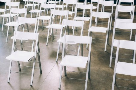Photo for Close up view of arranged empty white chairs in conference hall - Royalty Free Image