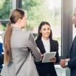 multiethnic business colleagues having conversation in office