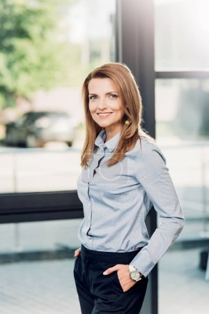 portrait of smiling businesswoman in conference hall