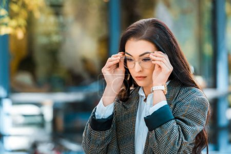 Photo for Beautiful brunette woman in trendy jacket and eyeglasses - Royalty Free Image