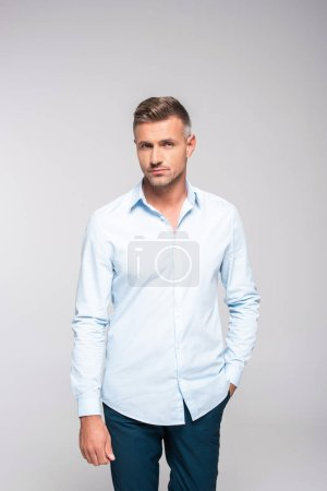 Photo for Attractive adult man in stylish clothes looking at camera on white - Royalty Free Image