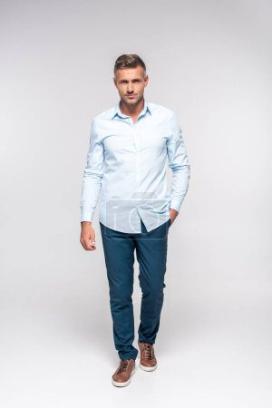 Photo for Handsome adult man in stylish clothes looking at camera on white - Royalty Free Image