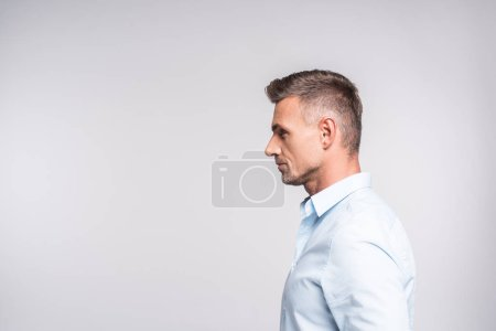 side view of handsome adult man in shirt isolated on white