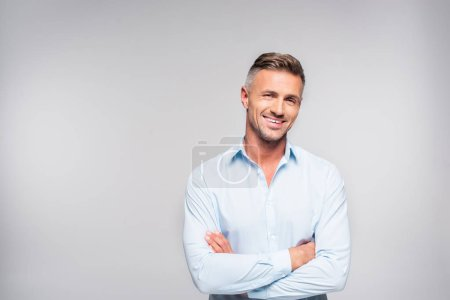 Photo for Smiling adult man with crossed arms looking at camera - Royalty Free Image