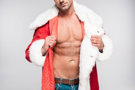 cropped shot of sexy muscular man wearing santa costume isolated on grey