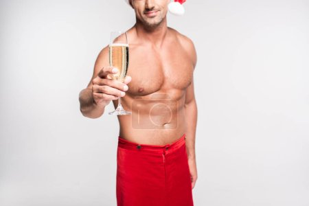 cropped shot of shirtless muscular man holding glass of champagne isolated on grey