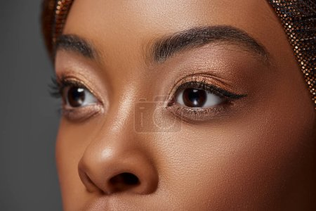 cropped shot of african american model looking away isolated on grey