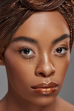 Photo for Portrait of beautiful african american woman with head wrap and bare shoulders isolated on grey - Royalty Free Image