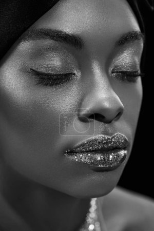 Photo for Black and white photo of stylish african american woman with eyes closed isolated on black - Royalty Free Image