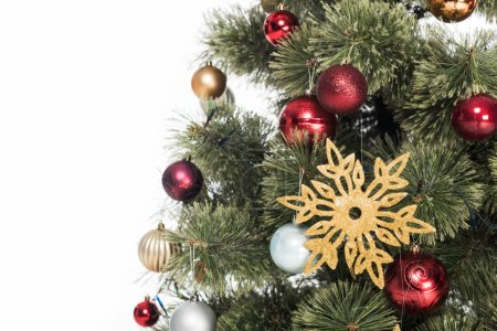 close up view of decorative toys on christmas tree isolated on white