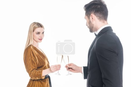 fashionable couple clinking glasses of champagne isolated on white