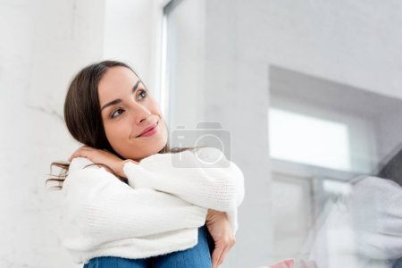 Photo for Bottom view of smiling thoughtful young woman looking up - Royalty Free Image