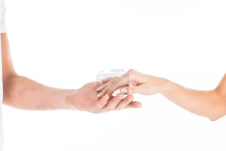 Partial view of people tenderly holding hands isolated on white