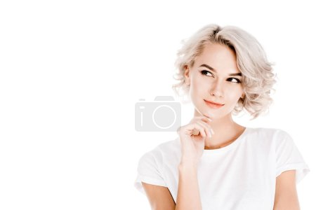 Wonderful  woman thoughtfullylooking away while touching her chin isolated on white