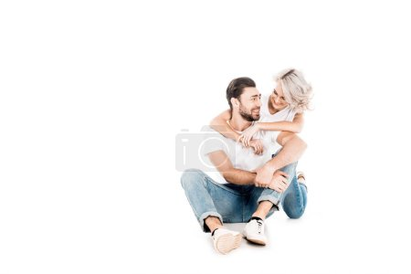Wonderful couple hugging while sitting isolated on white