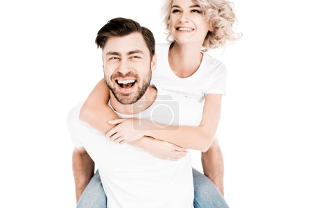 Photo for Happy couple having fun while man giving piggyback to woman isolated on white - Royalty Free Image