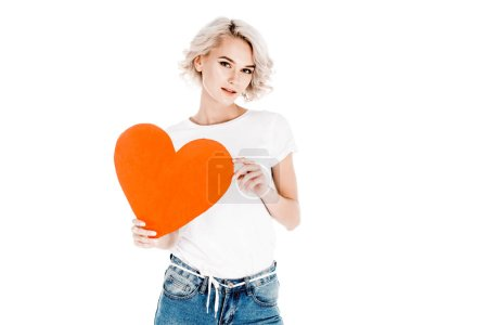 Wonderful young adult woman holding red heart isolated on white