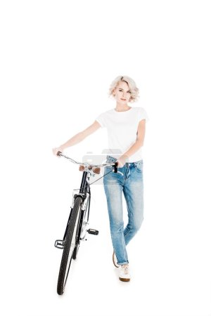 Attractive young adult woman with bicycle isolated on white