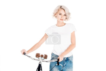 Wonderful blonde young adult woman with bicycle isolated on white