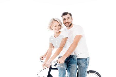 Wonderful couple riding bicycle together isolated on white
